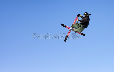 extreme skier jumps up high