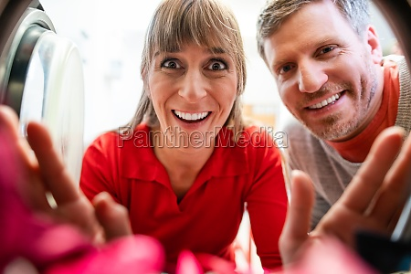 couple looks cheerfully in a washing