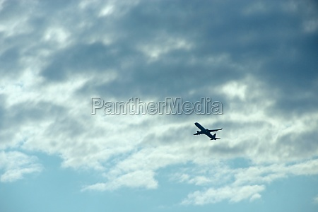 plane flying high in sky view