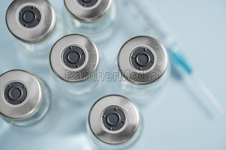 overhead view of vials with covid
