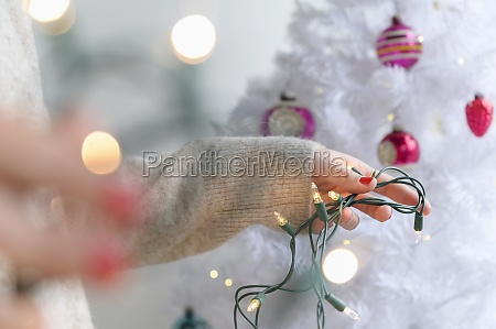 woman preparing to decorate christmas tree