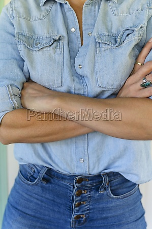 midsection of woman with arms crossed