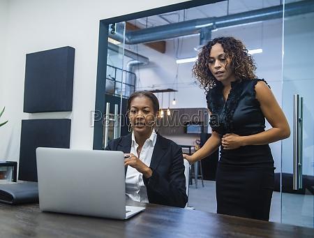 business women using laptop in office