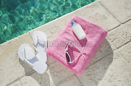 sandals and towel at poolside