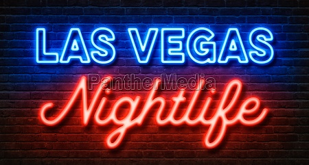 neon sign on a brick wall