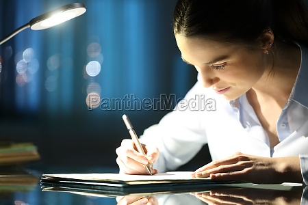 woman filling form in the night
