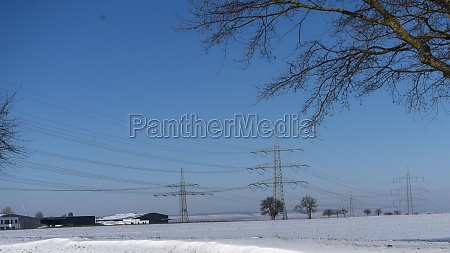 power pole in winter landscape