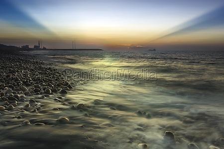 rocks on stone beach at sunset