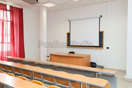 empty classroom with chairs desks and