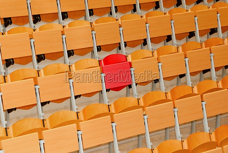 empty classroom with wood chairs and