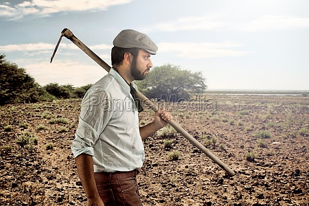 farmer walking through the fields