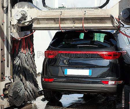 black car in automatic car wash