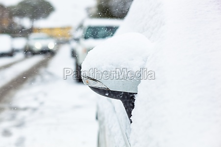 rearview mirror covered with snow