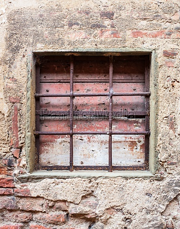 old window with iron gratings
