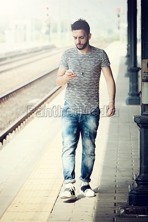 young man at the train station