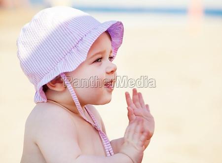 newborn baby girl at the sea