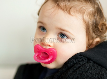 portrait toddler baby girl playing on
