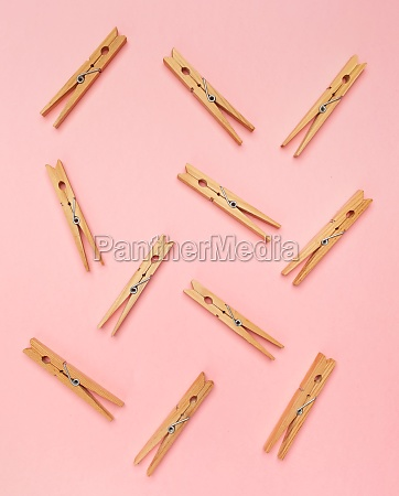 clothes pins on a pink background