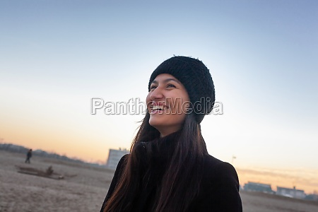 young woman laughing on the beach
