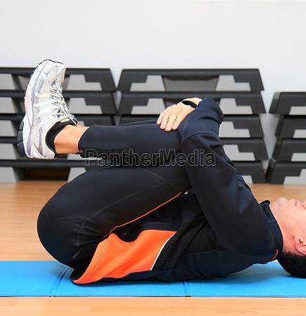 man doing postural exercises