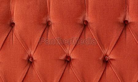 old pink velvet capitone textile background