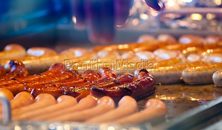 german sausages on the barbecue grill