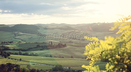 landscape of tuscany hills with lens