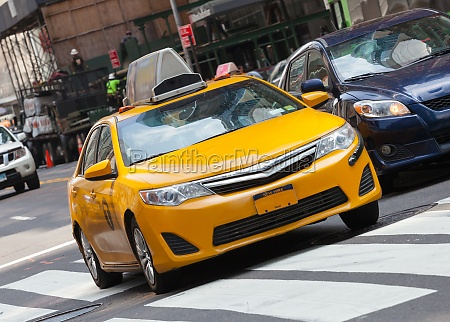 classic street view with yellow cab