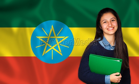 teen student smiling over ethiopia flag