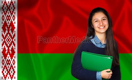 teen student smiling over belarusian flag