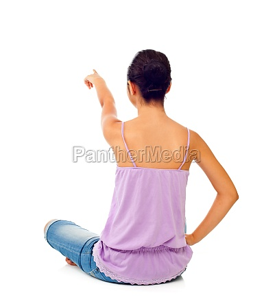 sitting teen girl while pointing with