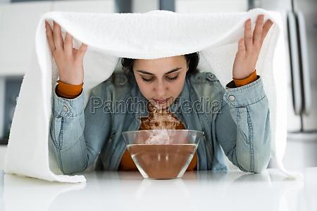 woman doing inhalation alternative herbal medicine