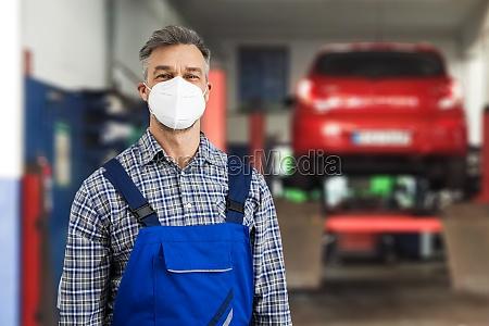 automotive mechanic technician doing car repair