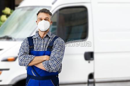 electricians repairman or plumber near van