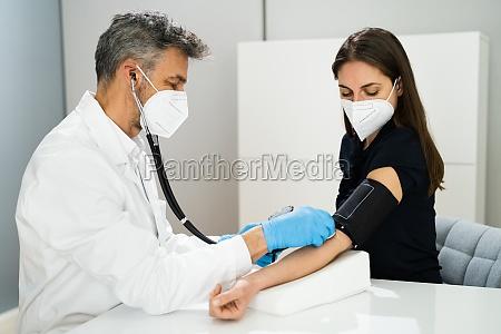 measuring blood pressure health check