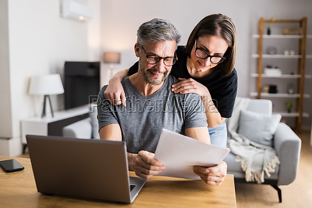 couple doing taxes and family budget