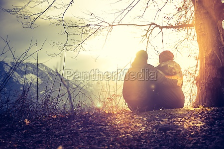 idyllic mountain sundown scenery young sitting