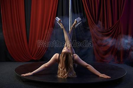 showgirl in lingerie pole dance striptease