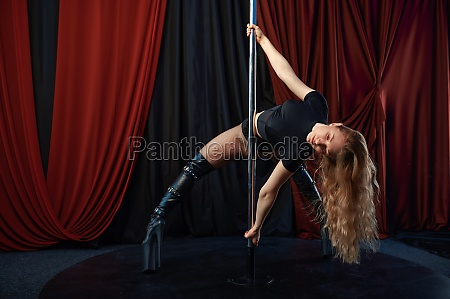 sexy showgirl on stage pole dance