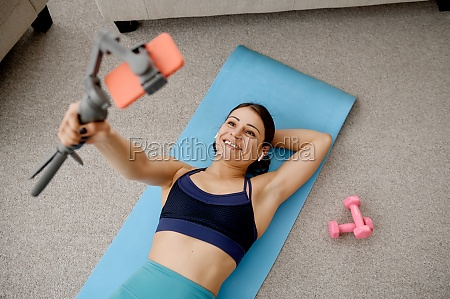 woman lying on mat online fit