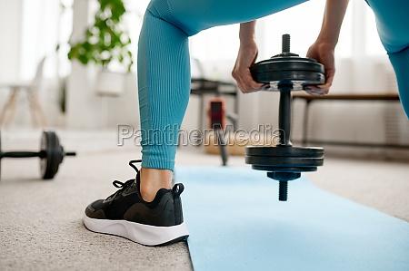 girl with dumbbell online fitness training