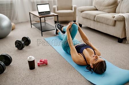 smiling girl sits on floor online