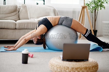 woman with ball online pilates training