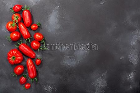 red heirloom tomatoes on dark textured