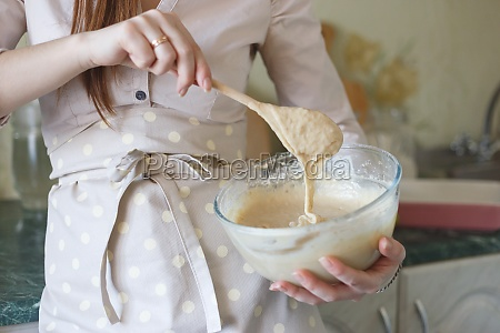 making dough for pie in bowl