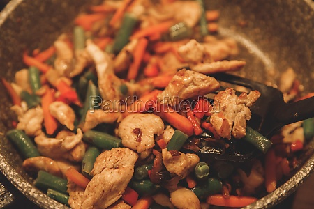 fried vegetables with turkey meat in