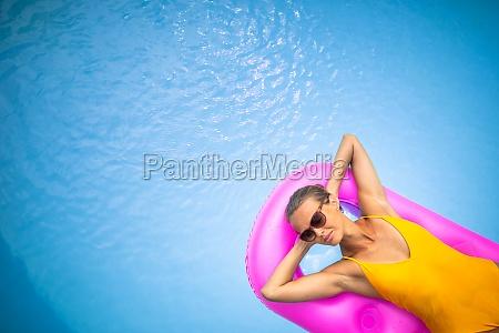 young beautiful suntanned woman wearing sunglasses