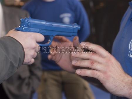 a blue training gun or pistol