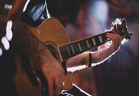 playing classic guitar selective focus