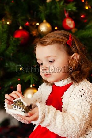 beautiful little child near christmas tree